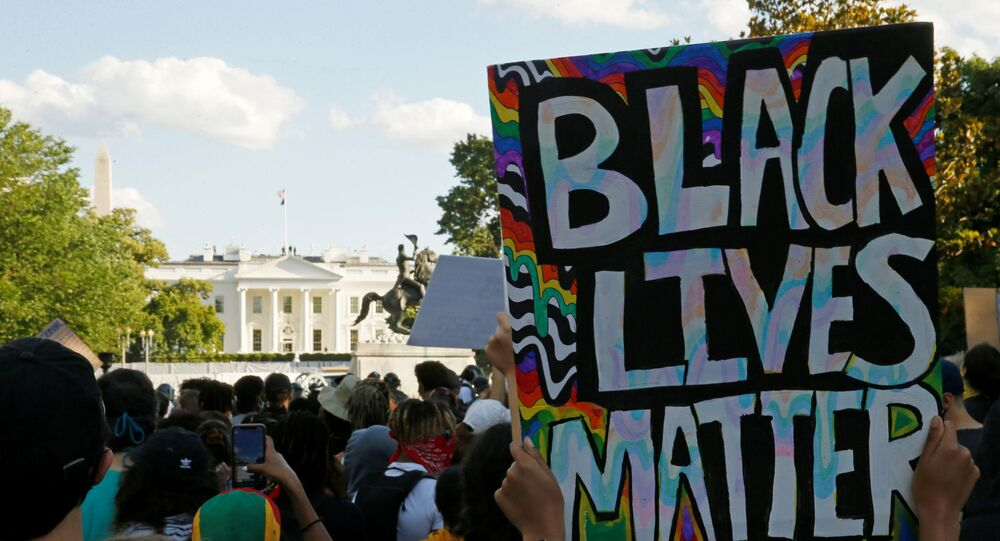 People attend a protest during nationwide unrest following the death in Minneapolis police custody of George Floyd, at Lafayette Park in front of the White House in Washington, U.S., May 31, 2020