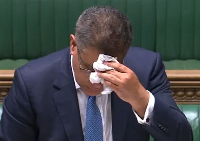 A video grab from footage broadcast by the UK Parliament's Parliamentary Recording Unit (PRU) shows Britain's Business Secretary Alok Sharma wiping his brow as he makes a statement in the House of Commons in London on June 3, 2020, as lockdown measures ease during the novel coronavirus COVID-19 pandemic