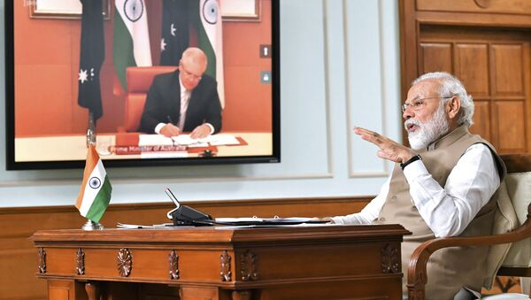 In this handout photo provided by the Press Information Bureau, Indian Prime Minister Narendra Modi speaks during a virtual meeting with Australian Prime Minister Scott Morrison, in New Delhi, India, Thursday, June 4, 2020 - Sputnik International