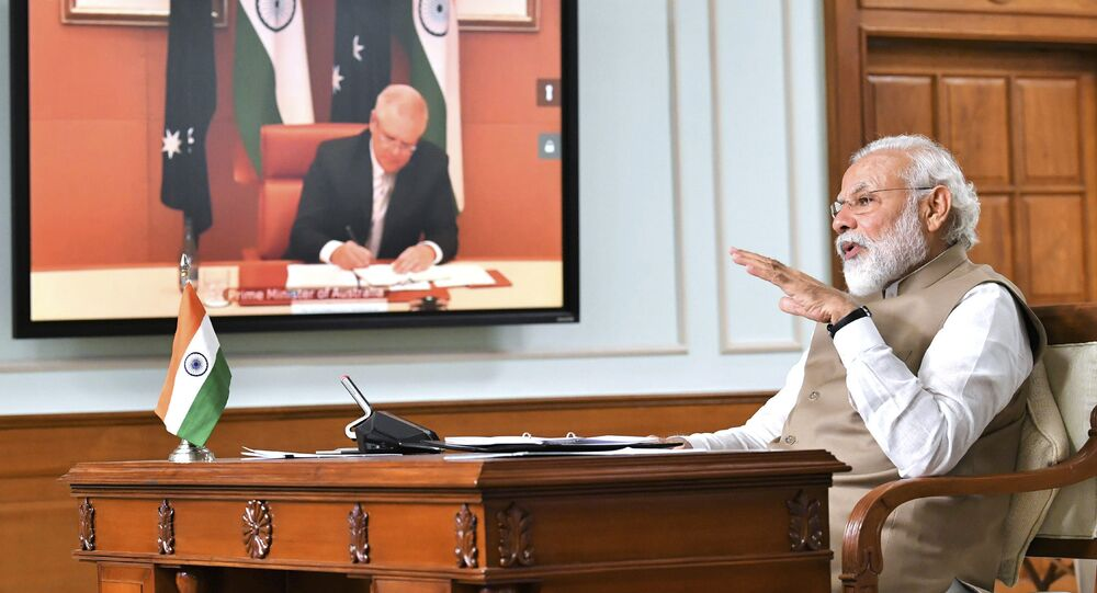 In this handout photo provided by the Press Information Bureau, Indian Prime Minister Narendra Modi speaks during a virtual meeting with Australian Prime Minister Scott Morrison, in New Delhi, India, Thursday, June 4, 2020