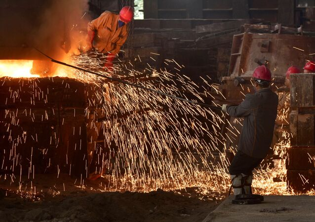 This photo taken on March 15, 2020 shows workers pouring molten steel at a foundry in Wuyi, China's eastern Zhejiang province