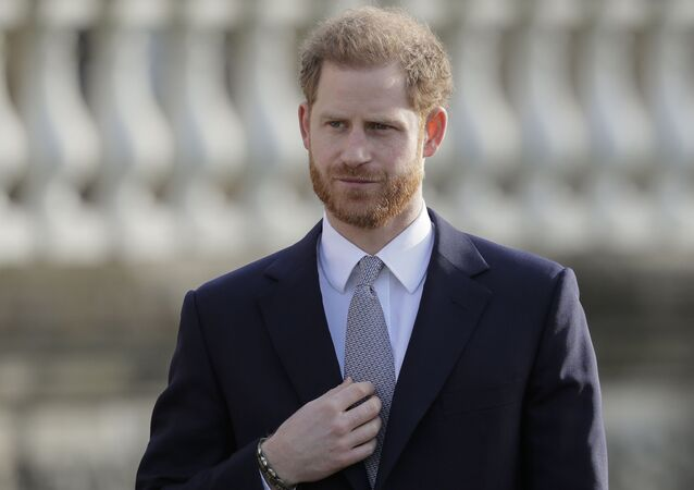 Britain's Prince Harry gestures in the gardens of Buckingham Palace in London, Thursday, Jan. 16, 2020. Prince Harry, the Duke of Sussex will host the Rugby League World Cup 2021 draw at Buckingham Palace, prior to the draw, The Duke met with representatives from all 21 nations taking part in the tournament