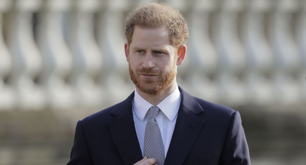 Britain's Prince Harry gestures in the gardens of Buckingham Palace in London, 16 January 2020. Prince Harry, the Duke of Sussex,, will host the Rugby League World Cup 2021 draw at Buckingham Palace. Prior to the draw, The Duke met with representatives from all 21 nations taking part in the tournament.