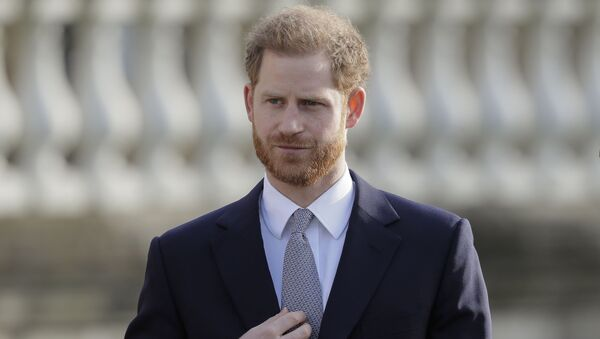 Britain's Prince Harry gestures in the gardens of Buckingham Palace in London, Thursday, Jan. 16, 2020. Prince Harry, the Duke of Sussex will host the Rugby League World Cup 2021 draw at Buckingham Palace, prior to the draw, The Duke met with representatives from all 21 nations taking part in the tournament - Sputnik International