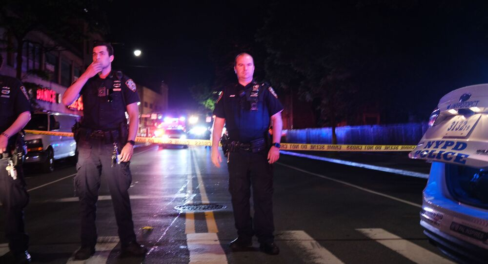 Police gather at the scene where two New York City police officers were shot in a confrontation late Wednesday evening in Brooklyn on June 03, 2020 in New York City.