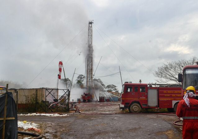 An Oil India Limited (OIL) firefighter oversees works near an oil well site following the May 27 blast at the Baghjan oil field of Tinsukia district, some 550 Kms from Guwahati, the capital of India's northeastern state of Assam on June 1, 2020
