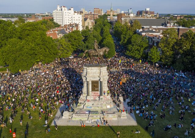 This Tuesday, June 2, 2020 file photo shows a large group of protesters gather around the statue of Confederate General Robert E. Lee on Monument Avenue near downtown in Richmond, Va. Virginia Gov. Ralph Northam is expected to announce plans Thursday for the removal of an iconic statue of Confederate Gen. Robert E. Lee from Richmond's prominent Monument Avenue.