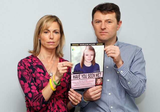 FILE PHOTO: Kate and Gerry McCann pose with a computer generated image of how their missing daughter Madeleine might look now, during a news conference in London May 2, 2012. REUTERS/Andrew Winning/File Photo