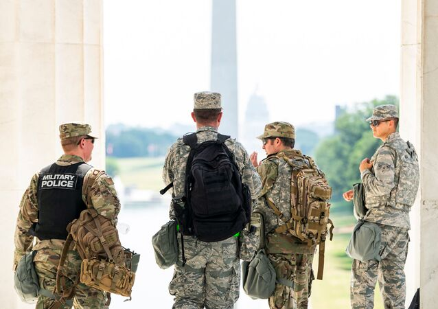 Members of the DC National Guard gear-up after a short rest from standing guard at the Lincoln Memorial during protests in DC over the death of George Floyd, in Washington, D.C., U.S., June 4, 2020