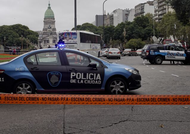 - Police cars are parked at a crime scene in Buenos Aires, Argentina, Thursday, May 9, 2019.