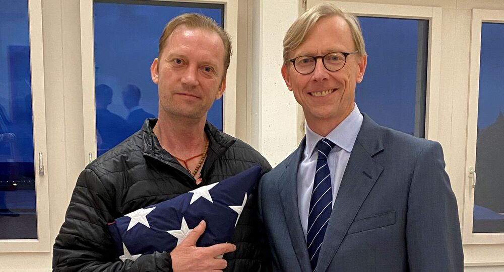 Michael White, a freed U.S. Navy veteran detained in Iran since 2018, poses with U.S. Special Envoy for Iran Brian Hook while on his return to the United States at Zurich Airport in Zurich, Switzerland June 4, 2020