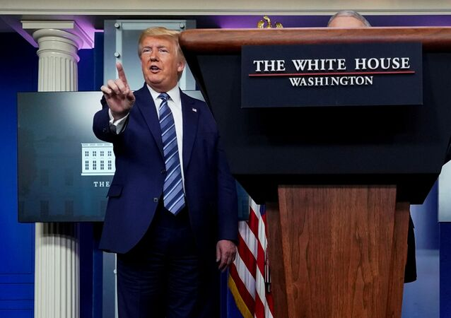U.S. President Donald Trump stops a reporter from asking Dr. Anthony Fauci a question about use of the drug hydroxychloroquine to treat the disease caused by the new coronavirus near the end of the daily coronavirus task force briefing at the White House in Washington, U.S., April 5, 2020