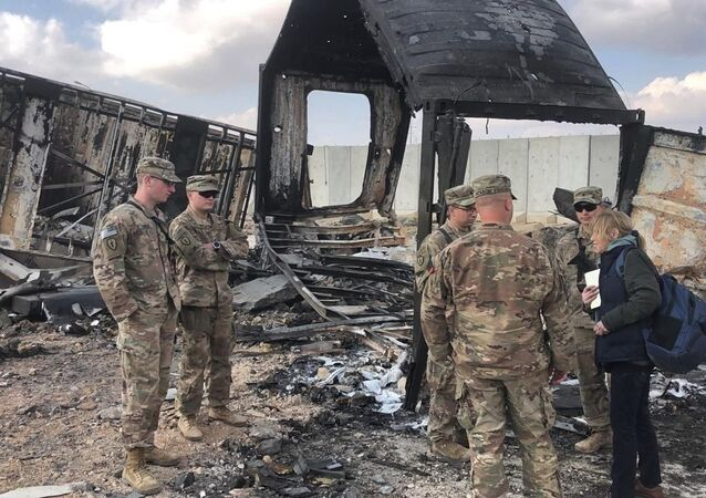 .S. Soldiers stand amid damage at a site of Iranian bombing at Ain al-Asad air base, in Anbar, Iraq, Monday, Jan. 13, 2020. Ain al-Asad air base was struck by a barrage of Iranian missiles on Wednesday, in retaliation for the U.S. drone strike that killed atop Iranian commander, Gen. Qassem Soleimani, whose killing raised fears of a wider war in the Middle East.