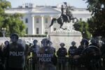 DC National Guard military police officers look on as demonstrators rally near the White House against the death in Minneapolis police custody of George Floyd, in Washington, D.C., U.S., June 1, 2020