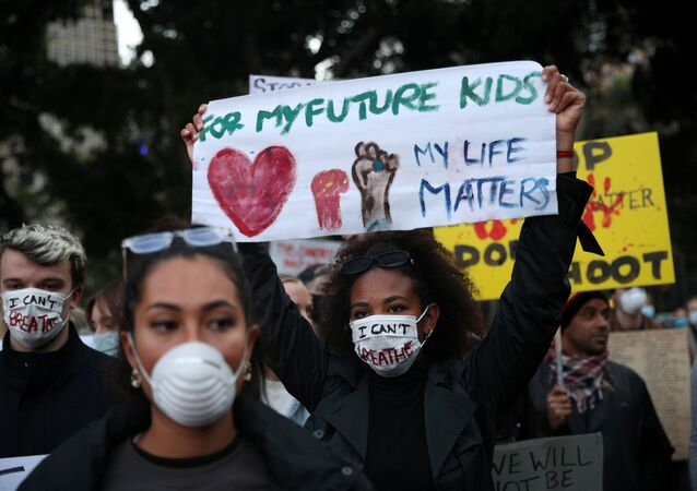 People protest in solidarity with those in the United States protesting police brutality and the death in Minneapolis police custody of George Floyd, in Sydney, Australia, June 2, 2020