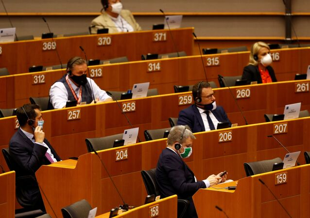Members of the European Parliament are seen during a plenary session on a new proposal for the EU's joint 2021-27 budget and an accompanying Recovery Instrument to kickstart economic activity in the bloc ravaged by the coronavirus disease (COVID-19) outbreak, in Brussels, Belgium, May 27, 2020.