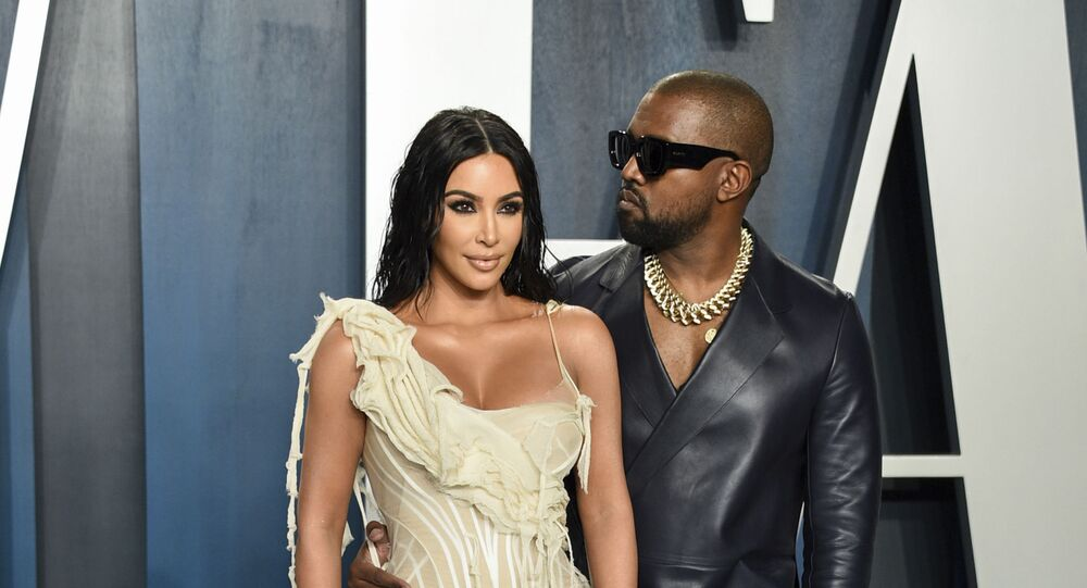 Kim Kardashian West, left, and Kanye West arrive at the Vanity Fair Oscar Party on Sunday, Feb. 9, 2020, in Beverly Hills, Calif
