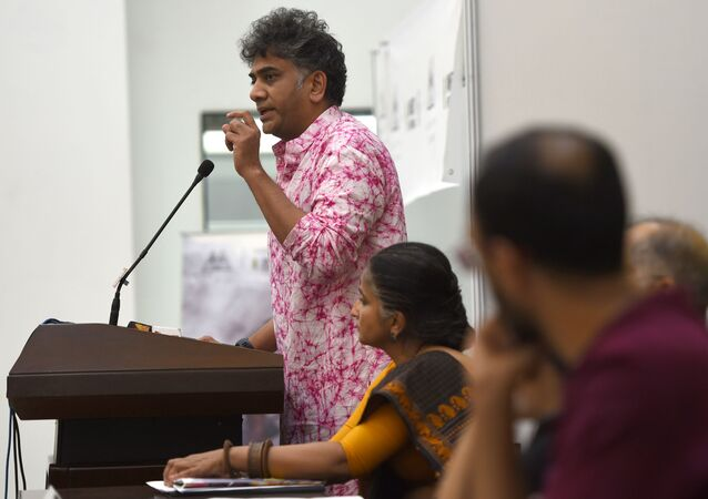 Executive Director, Amnesty international India, Aakar Patel (L)addresses a press conference in New Delhi on July 13, 2016