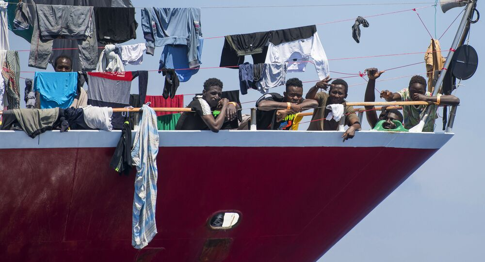 Migrants dry their clothes aboard a tourist boat some 20 kilometers from Malta, Tuesday, June 2, 2020. More than 400 migrants are living aboard pleasure cruise vessels, bobbing in the sea off Malta, many of them for weeks now. Rescued from human traffickers' unseaworthy boats in several operations in the central Mediterranean since late April, the migrants, along with the Maltese government, are waiting for European Union countries to offer to take them.
