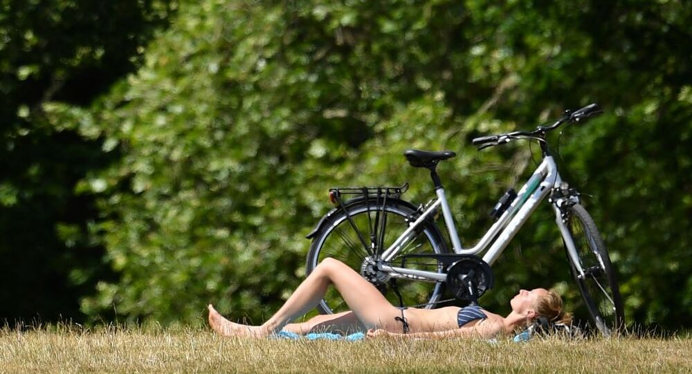 A woman sunbathes at Greenwich Park, south east London on June 2, 2020 following a further relaxation of the novel coronavirus COVID-19 lockdown rules.