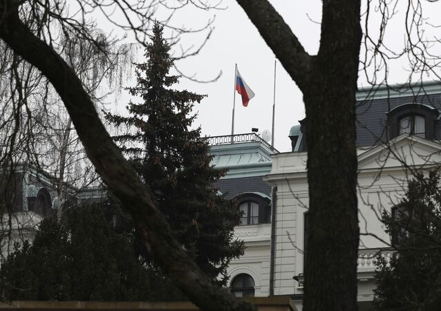 The Russian flag blows in the wind at the Russian embassy in Prague, Czech Republic, Monday, March 26, 2018