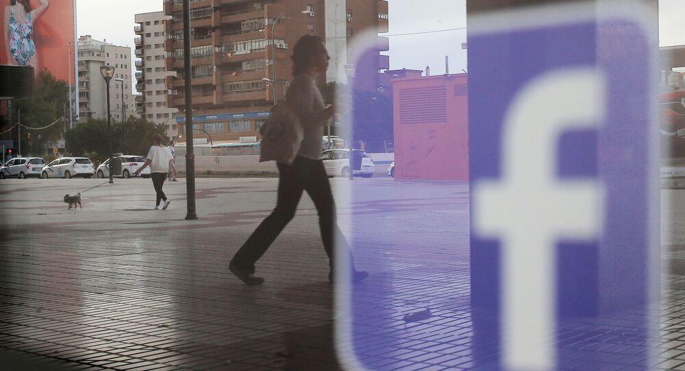 Facebook logo is seen on a shop window in Malaga, Spain, June 4, 2018