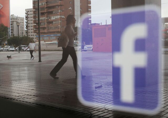 Facebook logo is seen on a shop window in Malaga, Spain, June 4, 2018