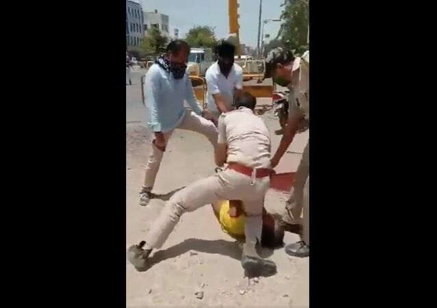 Cops throwing a person on the ground and pressing his neck