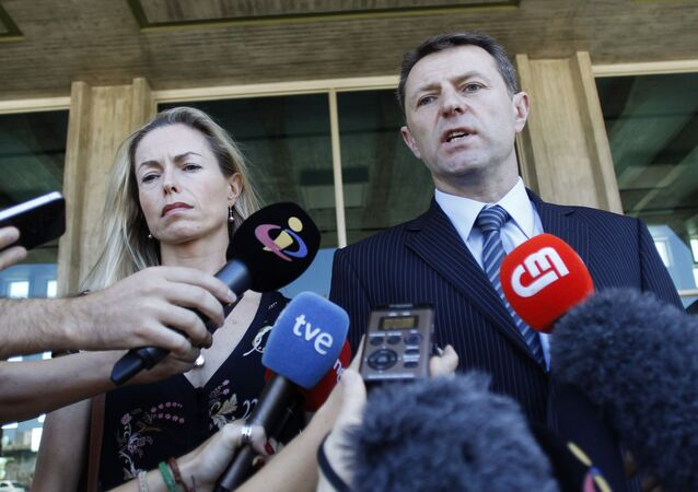 In this 8 July 2014 file photo, Kate McCann, left, and Gerry McCann, the parents of missing British girl Madeleine McCann talk to the media outside a court in Lisbon.