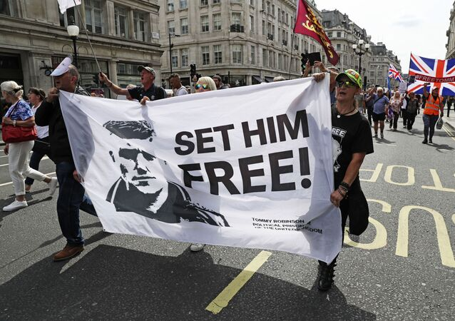 Supporters of far-right activist Stephen Yaxley-Lennon known as Tommy Robinson protest in Oxford Street, London,  Saturday, Aug. 3, 2019