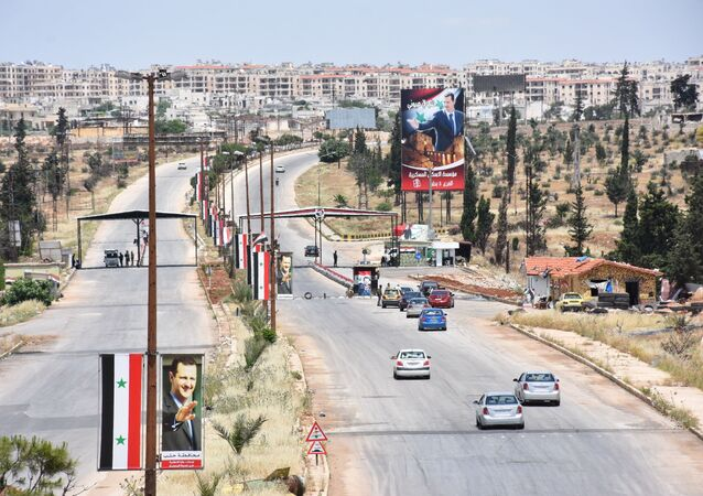 A view shows vehicles driving in Syria's northern city of Aleppo on the third day of Eid al-Fitr holiday as coronavirus restrictions are eased amid the COVID-19 pandemic, on May 26, 2020.