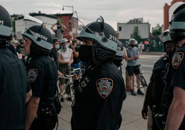 NYPD officers stand in line near a demonstration denouncing systemic racism in law enforcement in the borough of Brooklyn minutes before a citywide curfew went into effect on June 4, 2020 in New York City.