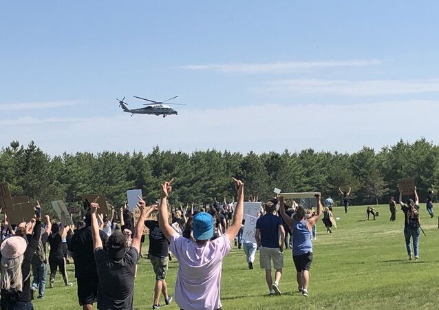 Protesters give Marine One the middle finger as Trump leaves for Guilford.