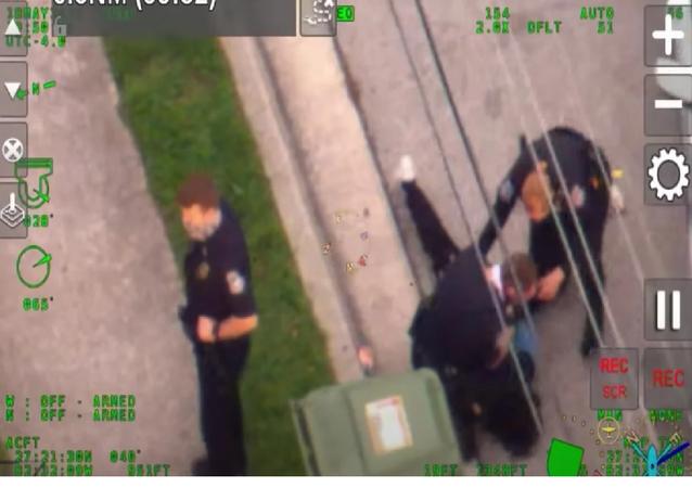 Probe Launched After US Cop Filmed Kneeling on Black Man's Neck