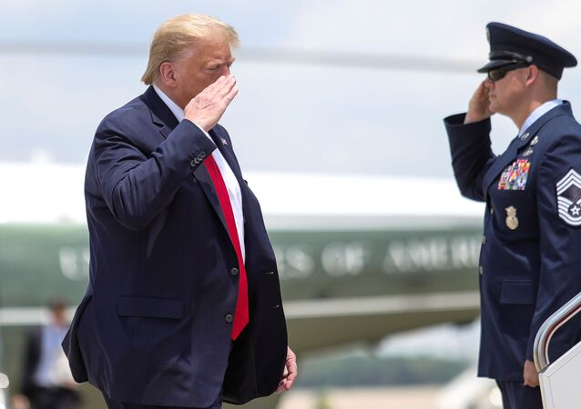 U.S. President Donald Trump returns a salute while boarding Air Force One as he departs Washington for travel to Guilford, Maine at Jont Base Andrews, Maryland, U.S., June 5, 2020.