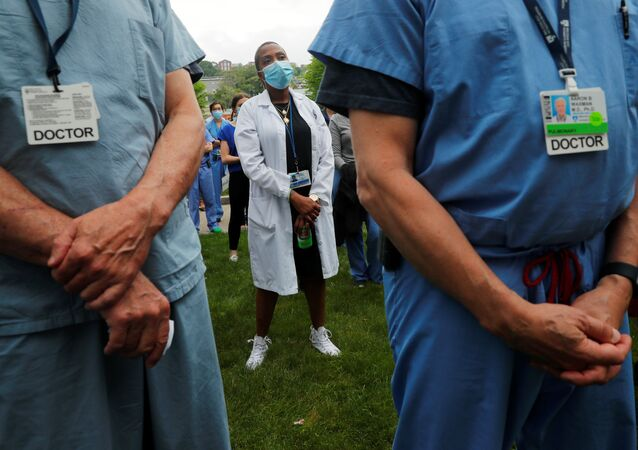 Nurses, doctors and hospital workers take part in a vigil at Brigham and Women's Hospital, where many coronavirus disease (COVID-19) patients have been treated, against the death in Minneapolis police custody of George Floyd, in Boston, Massachusetts, U.S., June 5, 2020