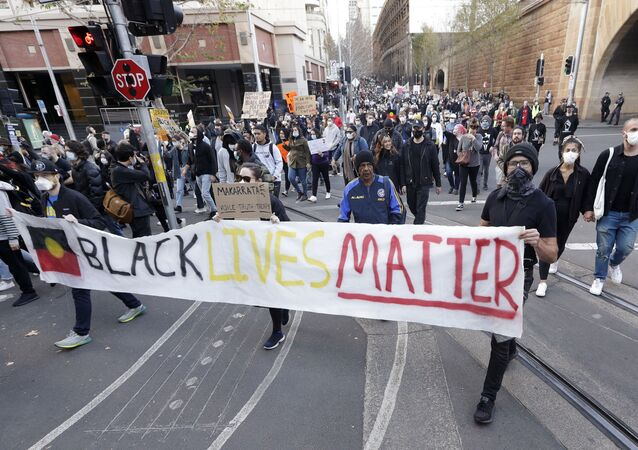 Protestors march in Sydney, Saturday, June 6, 2020, to support the cause of U.S. protests over the death of George Floyd. Black Lives Matter protests across Australia proceeded mostly peacefully as thousands of demonstrators in state capitals honored the memory of Floyd and protested the deaths of indigenous Australians in custody.