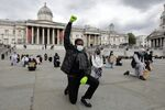 A protester makes a Black Lives Matter fist at a demonstration in Trafalgar Square in central London on June 5, 2020, to show solidarity with the Black Lives Matter movement in the wake of the killing of George Floyd, an unarmed black man who died after a police officer knelt on his neck in Minneapolis.