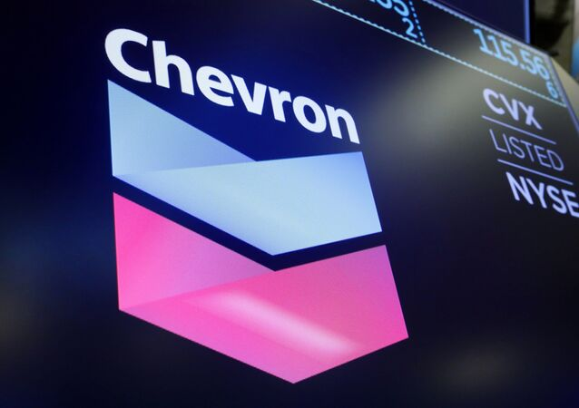 The logo for Chevron appears above a trading post on the floor of the New York Stock Exchange, Friday, 16 August 2019