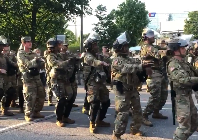National Guard troops in Atlanta, Georgia dance the Macarena minutes before curfew.