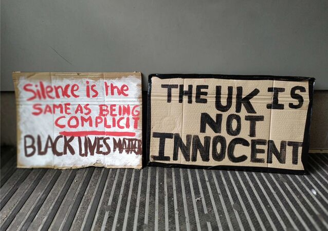 Banners at a protest in London on 6 June 2020