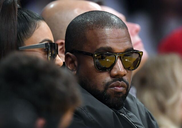 Kim Kardashian, left, and rapper Kanye West watch during the second half of an NBA basketball game between the Los Angeles Lakers and the Cleveland Cavaliers, 13 January 2020, in Los Angeles