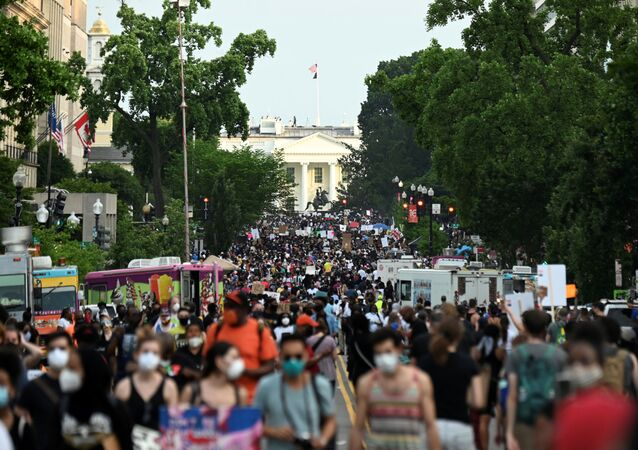 Demonstrators march on 16th St. near the White House, during a protest against racial inequality in the aftermath of the death in Minneapolis police custody of George Floyd, in Washington, U.S. June 6, 2020