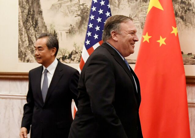 U.S. Secretary of State Mike Pompeo is seen near Chinese State Councilor and Foreign Minister Wang Yi before a meeting at the Diaoyutai State Guesthouse in Beijing, China October 8, 2018