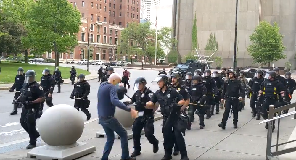 Screenshot of the video of Buffalo police officers shoving a 75-year-old man to the ground