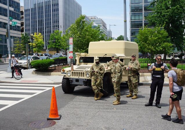 US National Guard personnel stand by a service vehicle during a demonstration against police brutality in Washington DC, US, 06.06.2020.