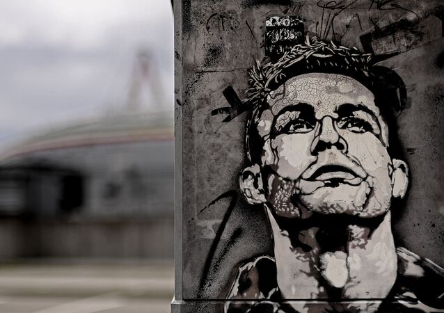 The image of Cristiano Ronaldo is painted on a mural outside the Juventus Stadium in Turin, Italy, Tuesday, May 19, 2020. Cristiano Ronaldo has reported back to Juventus' training center after a 10-week absence. The five-time Ballon d'Or winner showed up for medical tests with the Serie A leader Tuesday, May 19, 2020