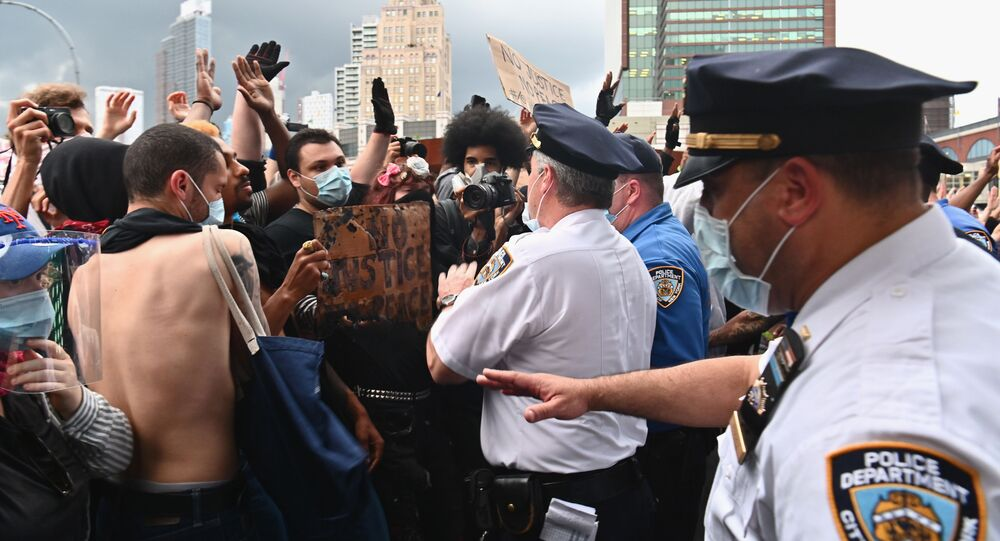 Police officers gesture to protesters gathered for a Black Lives Matter protest near Barclays Center on May 29, 2020 in the Brooklyn borough of New York City