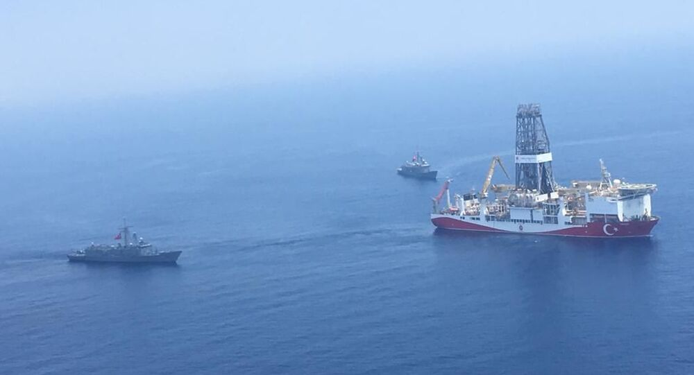 A handout photograph taken and released by the Turkish Defence Ministery on July 9,2019 shows a Turkish Navy warship patroling next to Turkey's drilling ship Fatih dispatched towards the eastern Mediterranean near Cyprus.