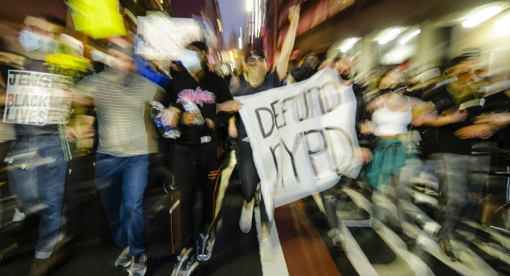 Protesters march during a solidarity rally for George Floyd, Friday, June 5, 2020, in the Brooklyn borough of New York. Floyd died after being restrained by Minneapolis police officers on May 25